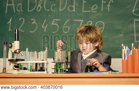Chemistry Lab. Back To School. Little Boy At Chemical Cabinet. Little Kid Learning Chemistry In Scho