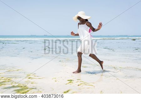 Beautiful Young Black African American Woman On The Tropical Beach