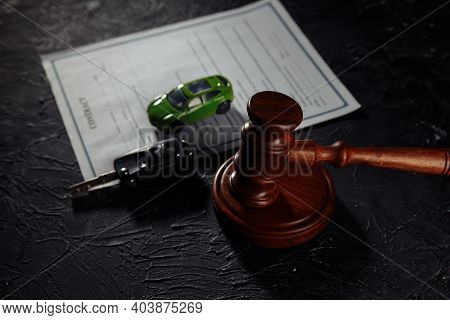 Car With Keys On Contract And Wooden Judge Gavel. Concept Of Selling A Car By Auction Or Accident Se