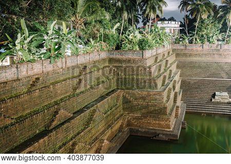 Ancient bathing ghat in Kunnrikka Sree Muchilot Bagavathi temple in Kerala, India