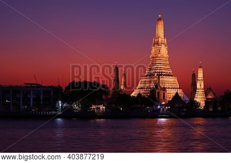 Incredible Evening View Of Wat Arun Or The Temple Of Dawn, Located On The West Bank Of Chao Phraya R