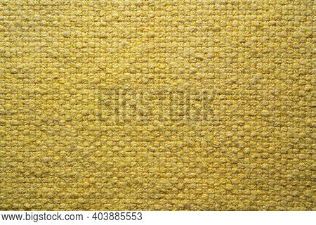 The Texture Of A Yellow Table Cloth