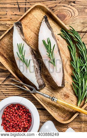 Raw Halibut Saltwater Fish Steak. Wooden Background. Top View