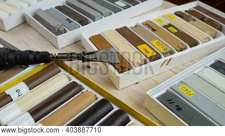Tools For Restoration Of Wooden Surfaces, Set Of Wax Pencils And A Soldering Iron For Repairing Scra