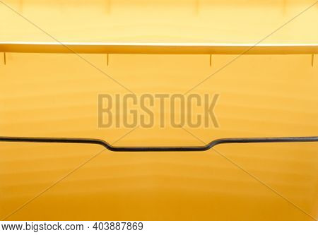 Abstract Yellow Background, Photographed Through The Skylight Of A Simple Plastic Bucket.