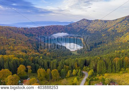 Aerial Autumn Lake With Morning Cloud  In Romanian Carpathians. Saint Anne Lake Is The Only One Crat