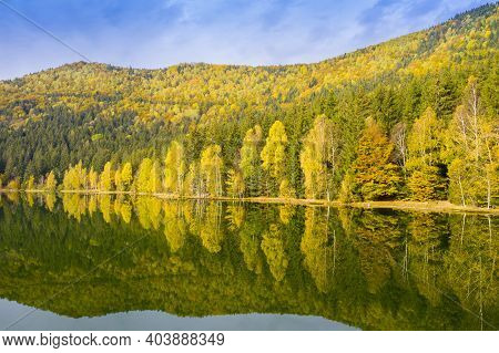 Golden Forest Trees Mirroring In Lake Water Surface. Saint Anne Lake Is The Only One Crater Lake Fro