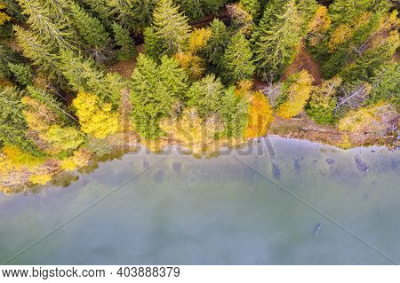 Autumn Forest Edge And Calm Lmountain Lake, Above Viewed. Saint Anne Lake Is The Only One Crater Lak