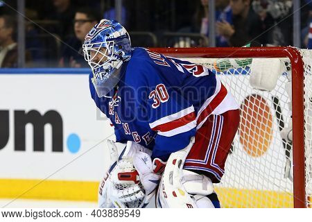 NEW YORK-APR 27: New York Rangers goalie Henrik Lundqvist (30) guards the goal against the New Jersey Devils during the third period at Madison Square Garden on April 27, 2013 in New York City.