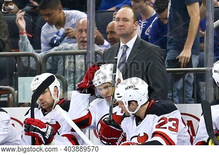 NEW YORK-APR 27: New Jersey Devils head coach Peter DeBoer behind the bench against the New York Rangers at Madison Square Garden on April 27, 2013 in New York City.