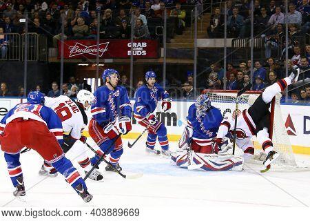 NEW YORK-APR 27: New Jersey Devils center Travis Zajac (19) and left wing Patrik Elias (26) against New York Rangers goalie Henrik Lundqvist (30) at Madison Square Garden on April 27, 2013 in New York
