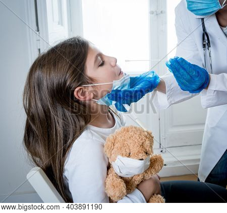Doctor Testing Girl For Coronavirus Infection Performing Nasal Swab, Pcr Or Rapid Covid-19 Test