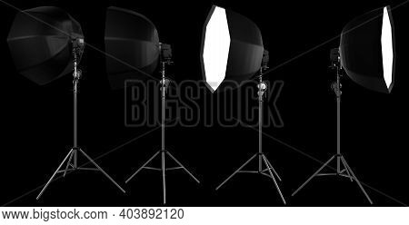 Studio Lighting Stands With Flash And Octobox Isolated On The Black Background With Clipping Path. 3