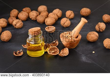 Walnut Melted In Spice Mortar. Walnut Oil.