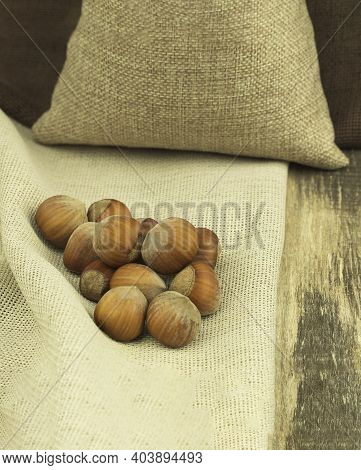 Hazelnuts In A Bag Close-up With Space For Text. Hazelnut, Genus Hazel. Nuts Of Large-fruited Forms