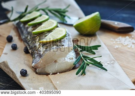 Raw Fish With  Lemon Slices And Rosemary.