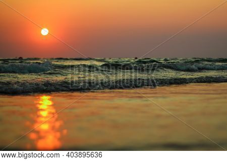 Wet Sea Sand On Beach Against Background Beautiful Golden Sunset. Close Up Sea Sand On Shore Ocean D