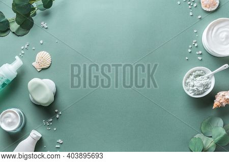 Skin Care, Body Treatment Products, Eucalyptus Leaves, Sea Salt, Aroma Oil  On Green Background, Top
