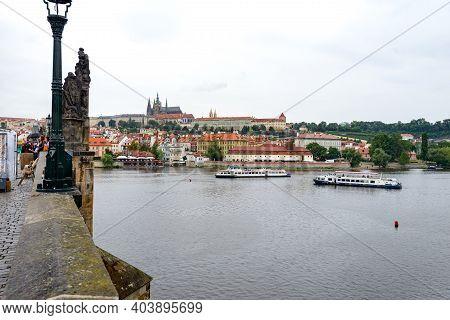 Prague, Czech Republic - July 24, 2017: Tourist Along The Charles Bridge, Czech: Karluv Most, Is A H