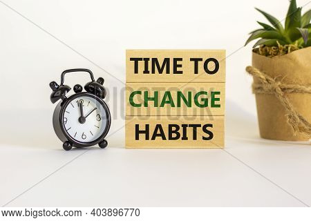 Time To Change Habits. Wooden Blocks With Words 'time To Change Habits'. White Table. Black Alarm Cl
