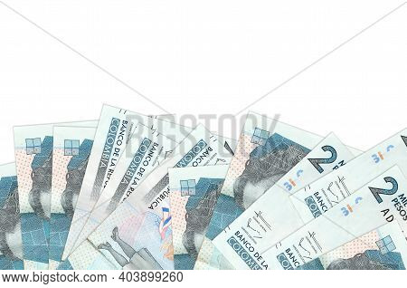 2 Colombian Pesos Bills Lies On Bottom Side Of Screen Isolated On White Background With Copy Space.