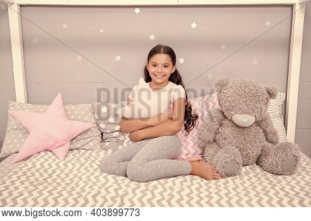 Pleasant And Cozy. Happy Child Feel Cozy In Bedroom. Small Girl In Cozy Wear. Home Clothing For Comf