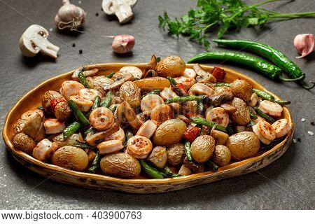 Side Dish Of Baked Vegetables Asparagus Bean, Pepper, Mushrooms And Sausage, Horizontal Orientation.