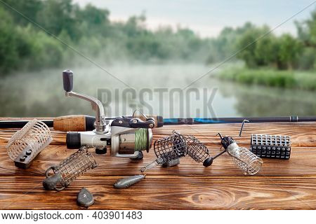 Fishing Tackle And Accessories On The Table Against The Background Of A Lake. Selective Focus