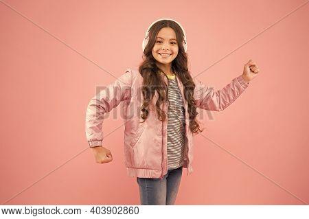 Music On. Happy Child Enjoy Listening To Sound Track. Little Girl Wear Earphones Pink Background. En