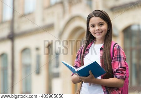 Happy Kid Back To School Reading Book Outdoors, Library, Copy Space.