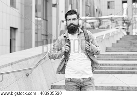Listen To It, Live It. Bearded Man Listen To Music Urban Outdoors. Hipster Wear Headphones In Casual