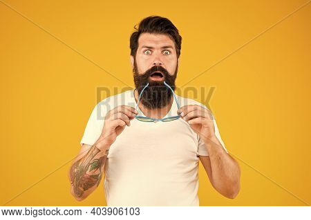 Super Crazy Surprise. Crazy Hipster Keep Mouth Open Yellow Background. Surprised Bearded Man Hold Gl