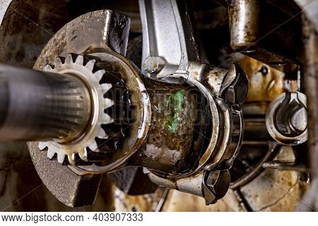 Crankshaft Mounted In A Small Internal Combustion Engine. The Interior Of The Gasoline Engine Compar