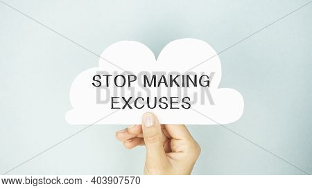 Closeup On Businessman Holding A Card With Text Stop Making Excuses, Business Concept Image With Sof