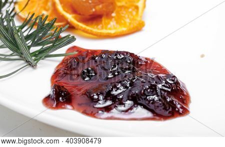 Blot Of Berry Jam Isolated On White And On A Background Of Fruits And Cheese