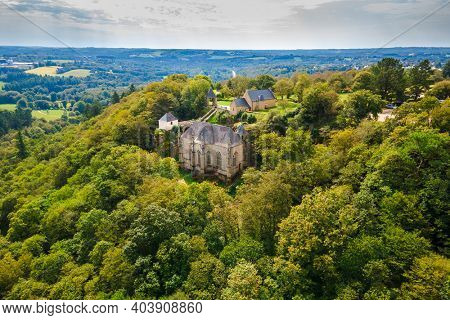Aerial view of the old Sainte Barbe chapel lost in the forest, Morbihan, Bretagne, France
