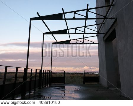 Empty Terrace With A Pergola, Overlooking The Clouds And Nature At Sunset. Relaxing Photo Of The Lan