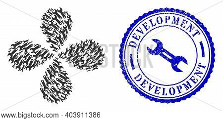 Spanner Tool Exploding Flower With Four Petals, And Blue Round Development Rubber Watermark With Ico