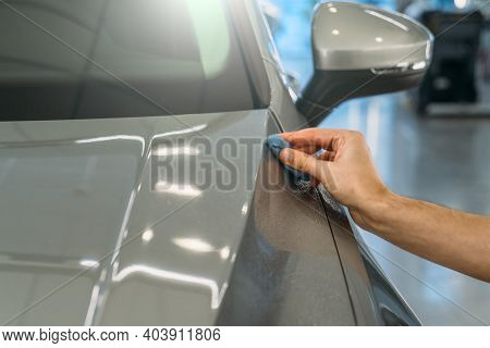Worker Hand Clean Car Body With Blue Clay For Cleaning Before Applying Protective Layer Or Coating T