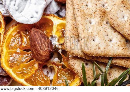 Still Life Close-up Of Nuts And Dried Orange And Biscuits