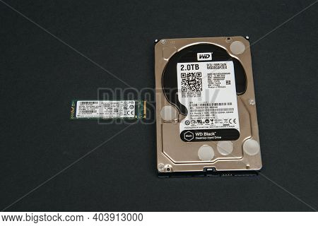 Paris, France - Jan 2, 2018: Comparing Large Hdd Hard Disk Drive From Western Digital To Small Nvme
