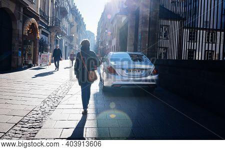 Strasbourg, France - Feb 16, 2019: Rear View Of French Elegant Woman Walking Near Luxury Mercedes-be