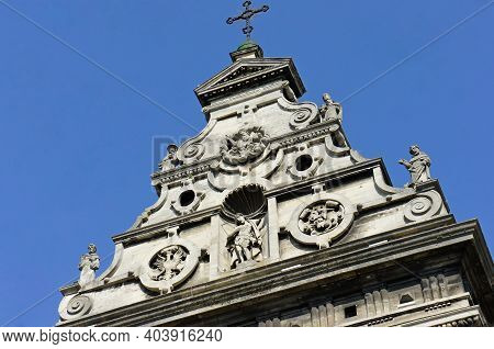 Old Catholic Church. The Upper Part Of The Facade Of The Catholic Church. Medieval Architecture. Scu
