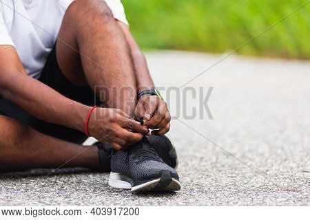 Close Up Asian Sport Runner Black Man Sitting Shoelace Trying Running Shoes Getting Ready For Joggin