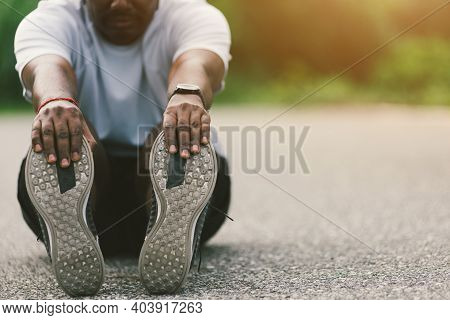 Close Up Asian Young Athlete Sport Runner Black Man Wear Watch He Sitting Pull Toe Feet Stretching L