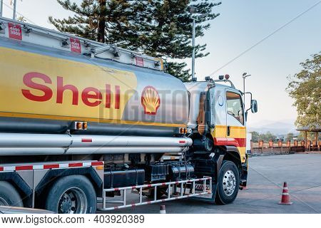 Chiang Mai, Thailand - Dec 15, 2020: Shell Gas Station And Trailer Truck During Sunset. Royal Dutch