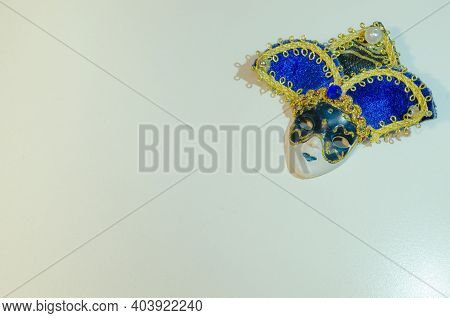 Blue And Golden Carnival Mask Souvenir On Light Background. Greeting Card With Copy Space. Tradition