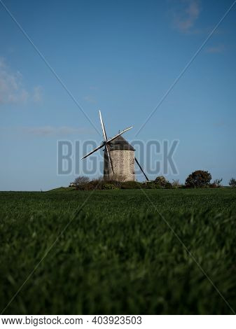 Panorama View Of Old Rustic Historic Windmill Moulin De Moidrey In Green Grass Field Meadow Pontorso