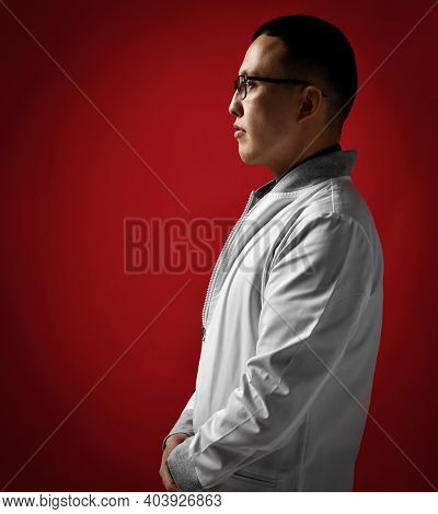 Portrait Profile Of Young Serious Man Doctor Urologist Or Proctologist Professional Expert In White
