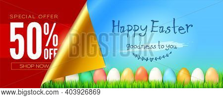 Banner For Easter Sale. Easter Eggs In Green Grass. Handwritten Greeting Text On Blue Sky Background